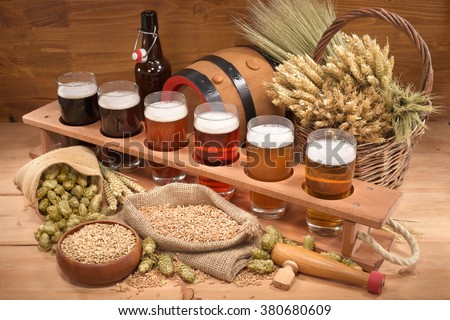 beer crate with many different beers, hops, wheat, grain, barley and malt