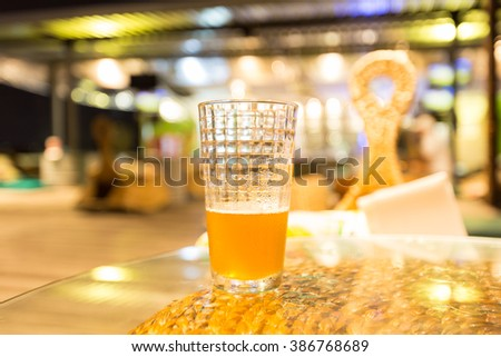 Beer drinkers On a glass table in a bar - stock photo