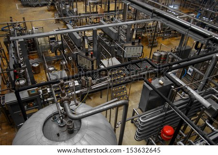 Beer factory interior with a lot of machines - stock photo