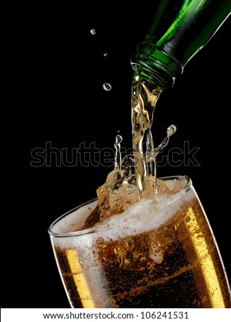 Beer flow in a glass - stock photo