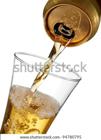 Beer flow in a glass from a can - stock photo