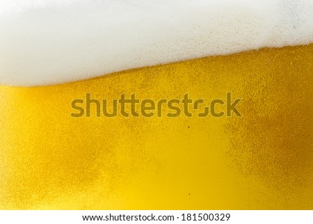 Beer foam wave with bubbles on golden Background