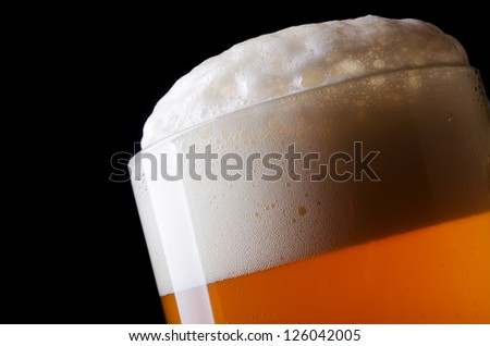 Beer froth in glass close-up - stock photo