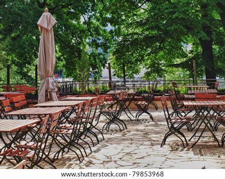 Beer garden awaits its guests - stock photo