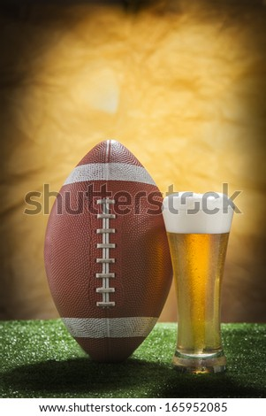 Beer glass and american football ball - stock photo