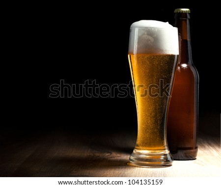 beer glass and bottle on a wooden table