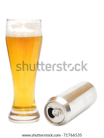 Beer glass and empty can isolated over white background - stock photo