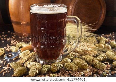 beer glass, beer barrels, hops, wheat, grain, barley and malt - stock photo