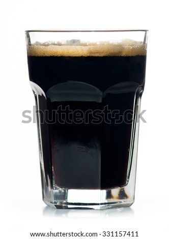 Beer glass full of cold black irish stout. Isolated. - stock photo