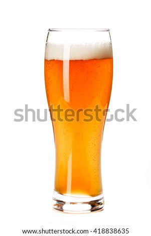 Beer Glass isolated. Beer glass on white background. Bar drink. Beer bubbles closeup. Lager. Overflow beer glass. Beer beverage. Glass of alcohol. Closeup draft beer glass. Cold Beer. Pint of beer.