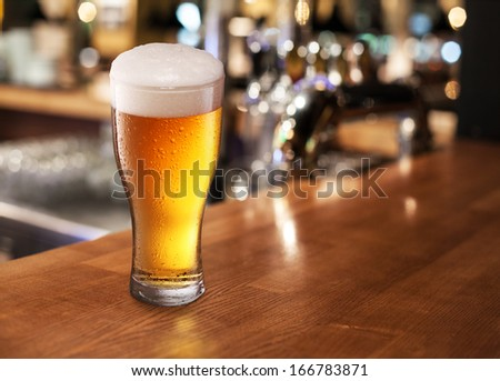 Beer glass on a bar table. Closeup. - stock photo