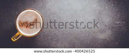 Beer glass on dark table. Close up - stock photo