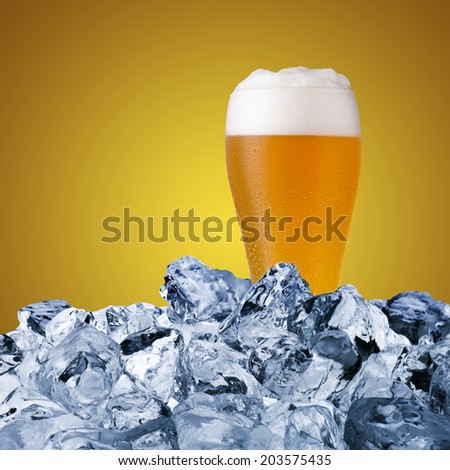 Beer glass on ice cubes - stock photo