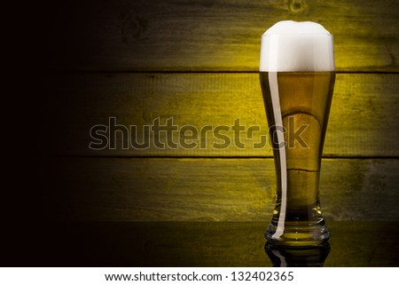 beer glass on wood background with copyspace - stock photo