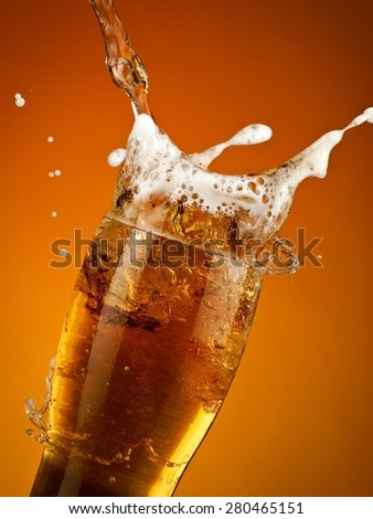Beer glass splash, close up