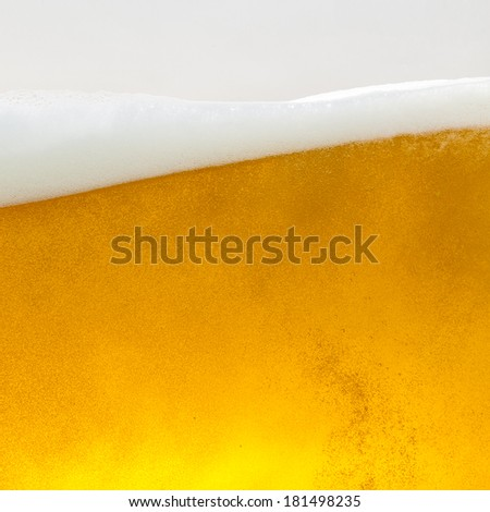 Beer glass wave with foam crown - stock photo