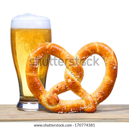 Beer Glass with German Pretzel on wooden table. isolated on white - stock photo