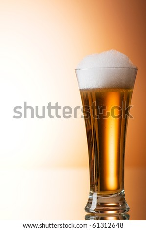 Beer glasses against the colorful gradient background - stock photo