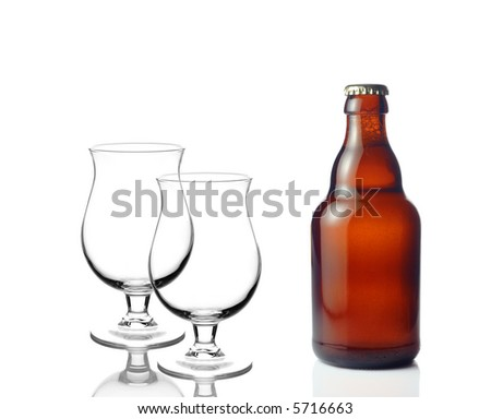 Beer glasses and a beer bottle isolated against  white background - stock photo