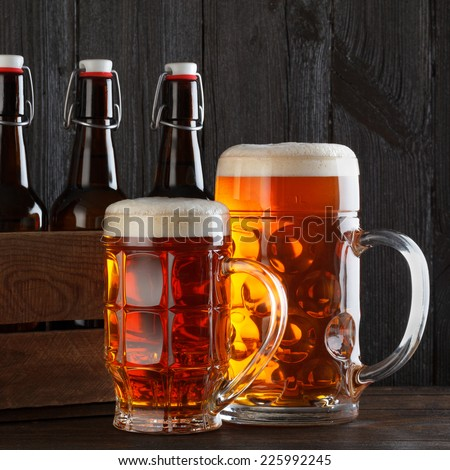 Beer glasses on table with crate - stock photo