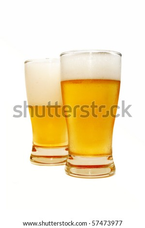 Beer glasses over white background - stock photo