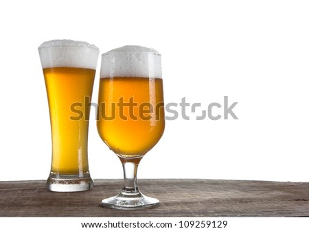Beer in a glasses over white - stock photo