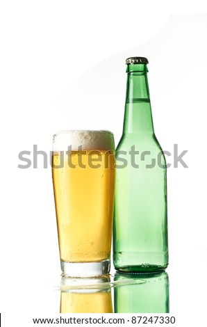 Beer in a green bottle and glass on a white background
