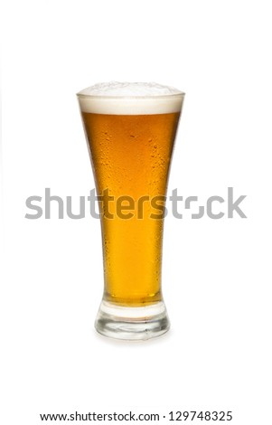 Beer In a pilsner glass isolated against white background. - stock photo