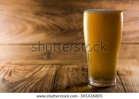 Beer in bottle on wood table - stock photo