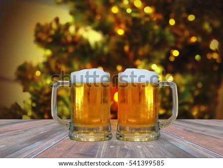 Beer in glass on wooden table,Christmas light background