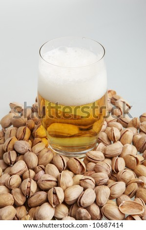Beer in glass with pistachioes