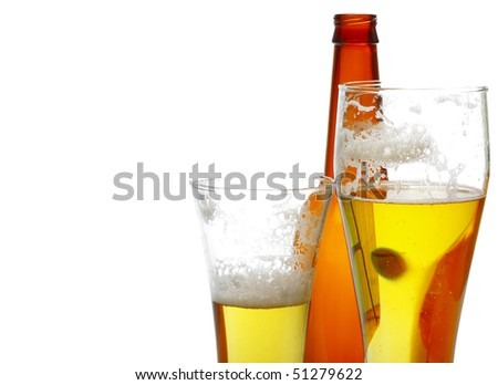 Beer in glasses and empty bottle