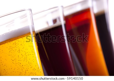 Beer in mug on white background - stock photo