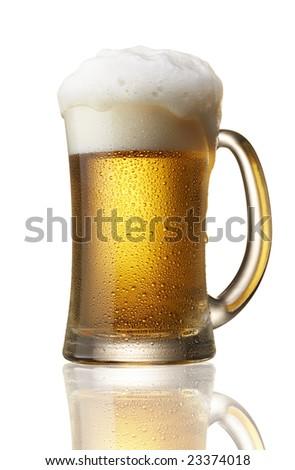beer in mug with foam over flow - stock photo