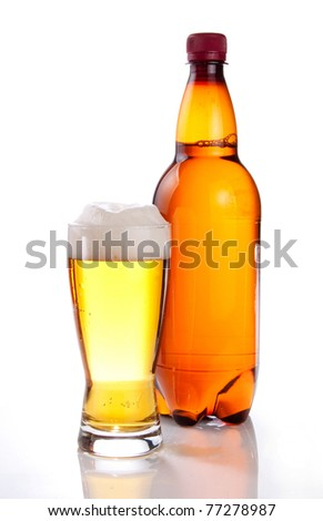 Beer in plastic bottle and glass on a white background