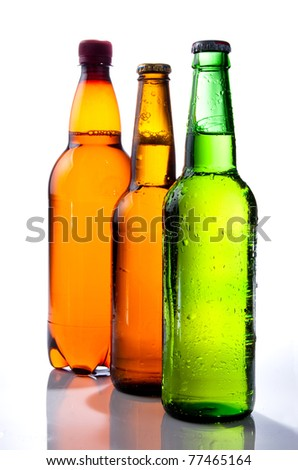 Beer in plastic bottle and Two glass bottles with beer, brown and green on a white background