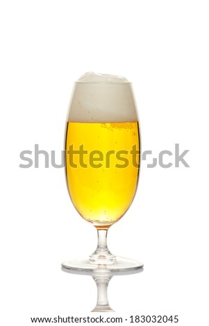 Beer into glass isolated on white