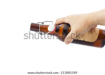 Beer is Pouring  on white  - stock photo