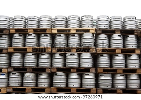 Beer kegs in rows over white background - stock photo