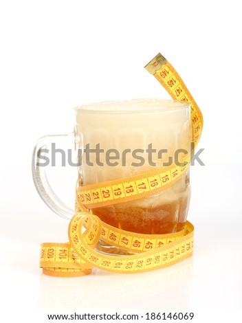 beer mug and tape measure on white. Diet concept - stock photo