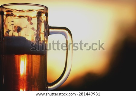 beer mug at sunset