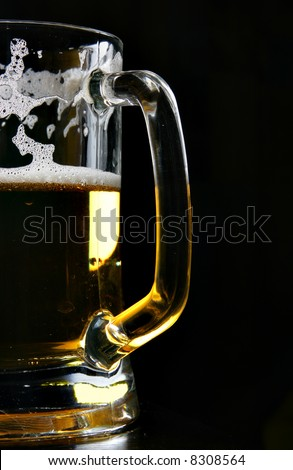 Beer mug close up over black background