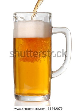 Beer mug isolated on white. Pouring beer in it.