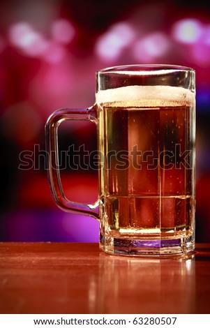 beer mug on a bar - stock photo