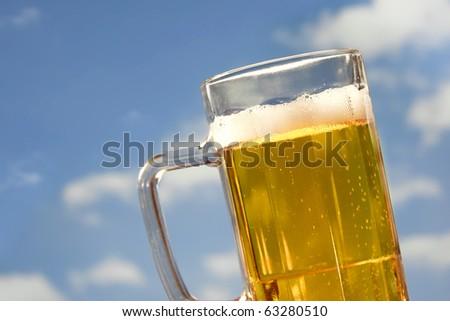 beer mug on blue sky - stock photo