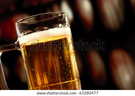 beer mug on vintage background - stock photo