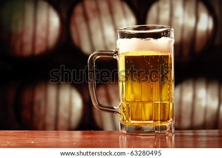 beer mug on vintage background - stock photo
