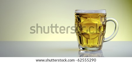 beer mug with a yellow background