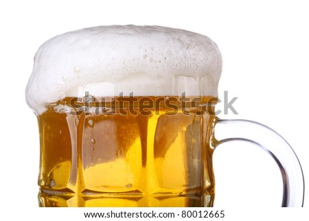 Beer mug with froth over white background - stock photo