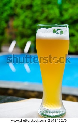 beer near the pool outdoors - stock photo